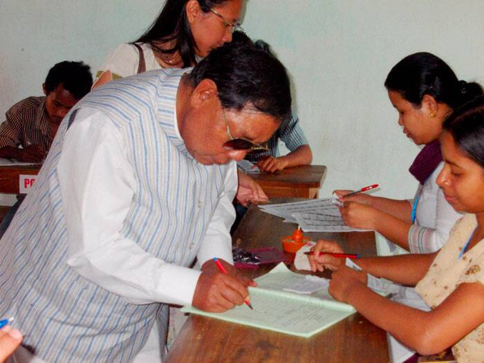 Sangma signs before casting his vote at a polling station during the second phase of polling for Lok Sabha elections at Tura in Meghalaya on Wednesday. PTI