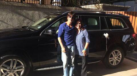 SRK and Farah Khan with the new Mercedes. (Twitter)