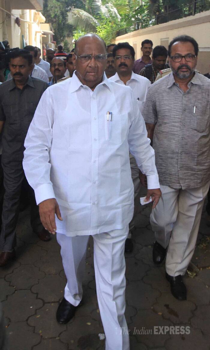 NCP leader Sharad Pawar arrives at the polling booth to vote. (IE Photo: Vasant Prabhu)