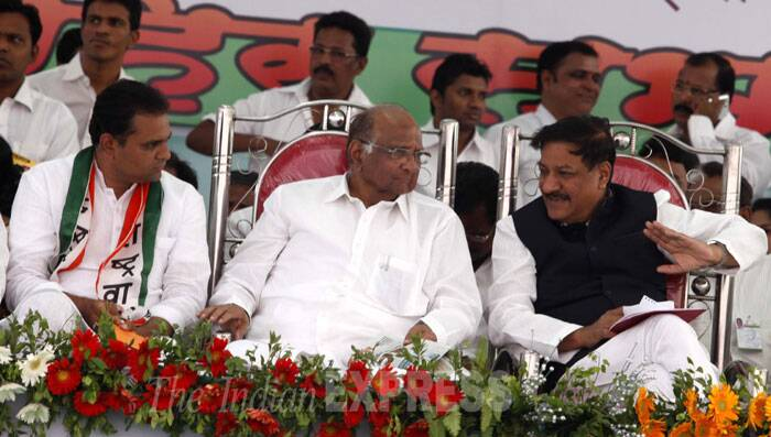 NCP President Sharad Pawar ,CM Prithviraj Chavan and NCP Candidate for Lok Sabha election Rahul Narvekar during a rally which was held at Kamote, Navi Mumbai on Friday. (IE Photo: Narendra Vaskar)