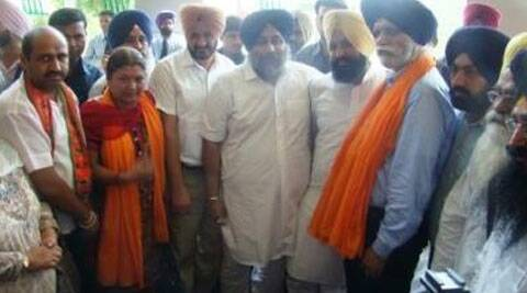Deputy Mayor R D Sharma with party members.