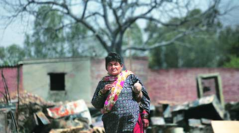 An inmate with her dolls at the old age home which was gutted in a fire on Friday. (Oinam Anand)