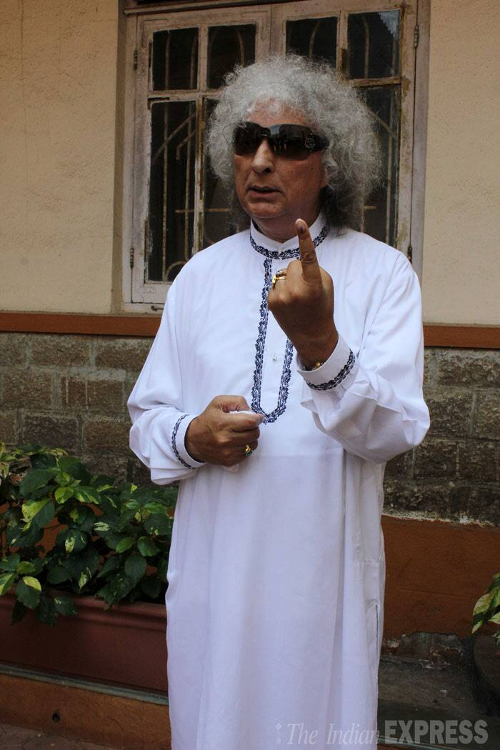 Santoor maestro Shivkumar Sharma shows his inked finger after casting his vote for Lok Sabha polls in Mumbai on Thursday. (IE Photo: Varinder Chawla)
