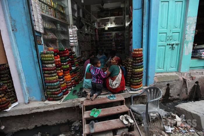 Women are seen buying bangles at a shop on the main street of Bhadarsa, a small village town near Faizabad which was also hit by the spate of violence during the Muzaffarnagar riots in 2012. (IE Photo: Tashi Tobgyal)