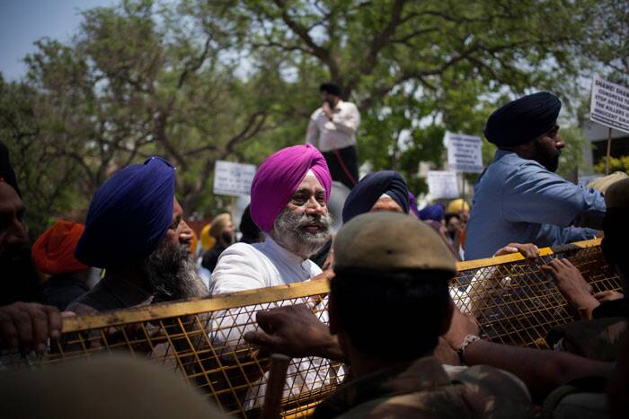 In his recent remarks to a private channel Singh had said that he believed Congress leader Jagdish Tytler played no role in fuelling the violence in 1984 that left hundreds of Sikhs dead. <br /><br /> Sikhs stand near a police barricade during a protest against Congress party leader and former chief minister of Punjab state Captain Amarinder Singh for his recent remarks on the country's 1984 anti-Sikh riots. (AP)
