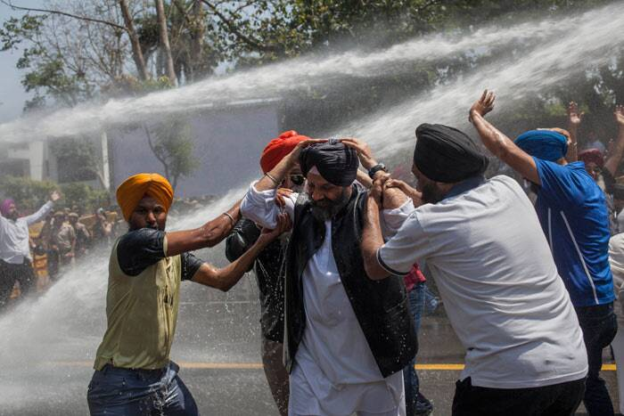 As the protesters refused to budge, police resorted to use of water cannon to disperse them. (AP)