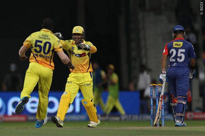 Chennai Super Kings captain MS Dhoni celebrates a wicket with teammate Dwayne Smith. (BCCI/IPL)