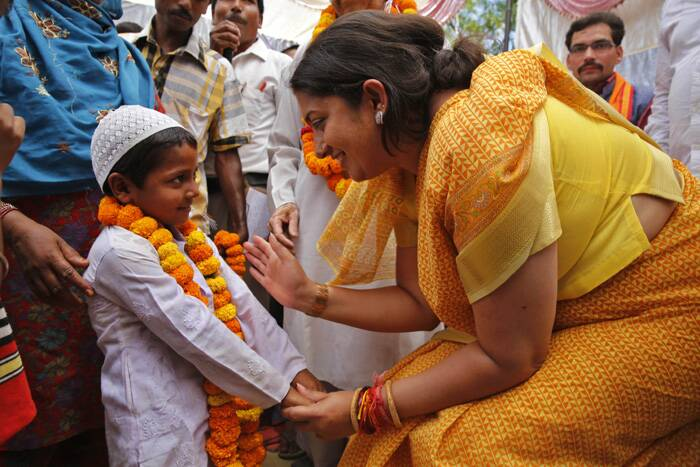 Smriti Irani talks to a young Muslim boy at the election rally. (AP)