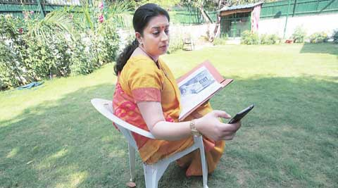 Smriti Irani at her Delhi home Tuesday; she takes on Rahul Gandhi and Kumar Vishwas in Amethi. (Express Photo: Renuka Puri)