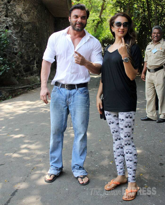 Bollywood actor Salman Khan's younger brother, Sohail Khan along with his wife Seema Khan, displays their inked fingers after casting their votes for Lok Sabha polls in Mumbai. (IE Photo: Varinder Chawla)