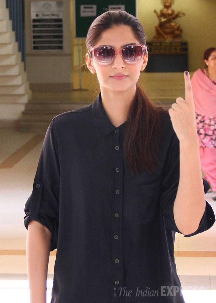 Sonam Kapoor shows her inked finger after casting her vote. (IE Photo: Amit Chakravarty)