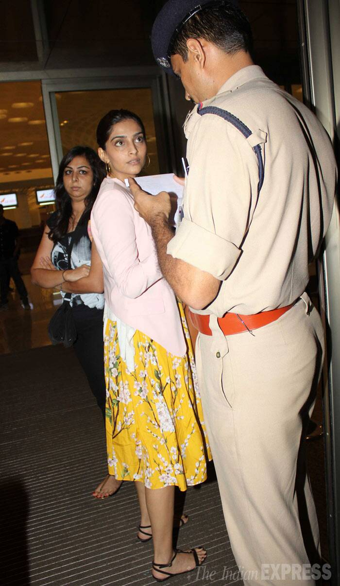 Sonam Kapoor gets her papers checked as she enters the terminal. (Photo: Varinder Singh)