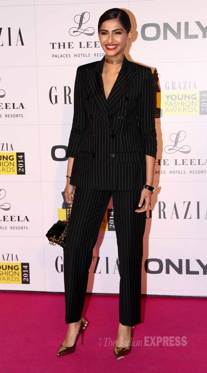 Bollywood's fashion girls Sonam Kapoor, Esha Gupta, Shraddha Kapoor, Aditi Rao Hydari, Sophie Choudry, Lisa Haydon upped the glam quotient at the Grazia Young Fashion Awards 2014 held in Mumbai on Sunday (April 13). <br /><br /> Inspired by Angelina Jolie's Tuxedo look earlier this year for BAFTAs 2014, our very own fashionista Sonam Kapoor too stepped out in a pinstripe double-breasted suit and yes she looked fab. She wore a vintage Givenchy necklace, tied her in a knot and finished off her look with Alexander McQueen pumps.(Photo: Varinder Chawla)
