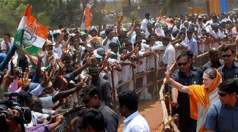 Congress President Sonia Gandhi waves to supporters at an election campaign meeting in Kanyakumari. (PTI)