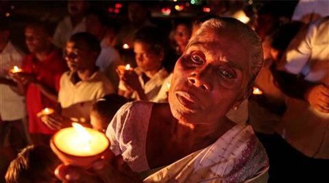 Sri Lankan government supporters hold oil lamps during a vigil condemning the U.S. backed resolution against Sri Lanka. (AP)