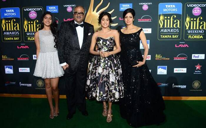 Sridevi's equally stylish teenage daughter Jhanvi Kapoor sashayed down in a Dolce & Gabbana floral print full-skirted dress. Like mom, Jhanvi also opted for soft makeup and minimal jewellery, however we wish Jhanvi had opted for something other than the ankle-strap sandals. <br /><br /> Seen Here, Sridevi and her filmmaker husband Boney Kapoor pose with their daughters Jhanvi and Khushi at IIFA green carpet. (Photo: Twitter)