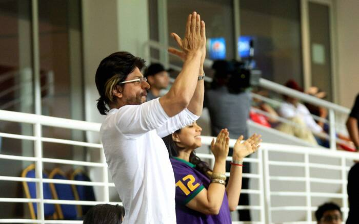 Bollywood actor Shah Rukh Khan gave the IIFA awards, underway in Tampa Bay, Florida a miss in favour of the ongoing IPL season 7 in Abu Dhabi. The actor was spotted cheering his team Kolkata Knight Riders, who lost to Kings XI Punjab at the Sheikh Zayed Stadium, Abu Dhabi. (PTI/BCCI)