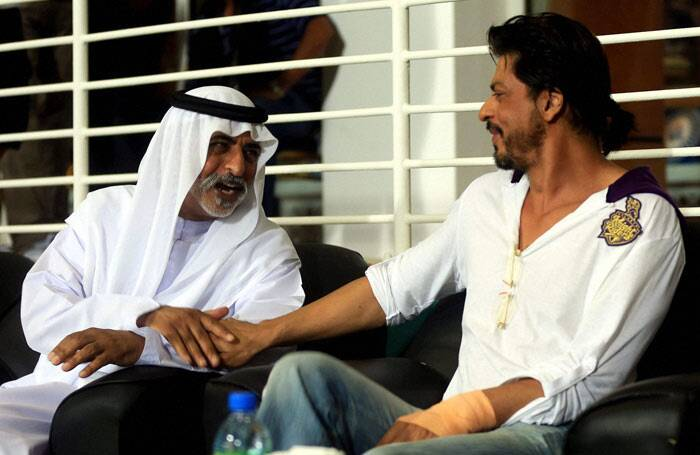 SRK interacting with His Excellency Shaikh Nahayan Mubarak during an the KKR and RR IPL 7 match  on Tuesday in Abu Dhabi. (PTI)