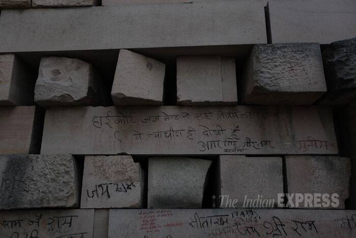 Huge blocks of concrete are seen with slogans and writings at the Ayodhya Ram Mandir museum, a workshop for preparing the infrastructure of the Ram Mandir, according to the Hindu groups. The museum over the years has ended up itself becoming a pilgrimage and a tourist site, where visitors from all over the country make sure to reach here during their trip to the temple town in Uttar Pradesh. (IE Photo: Tashi Tobgyal)