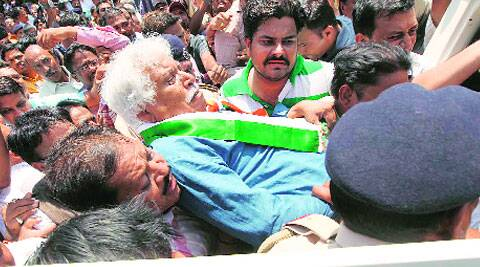 Madhusudan Mistry is dragged into a police van . Bhupendra Rana