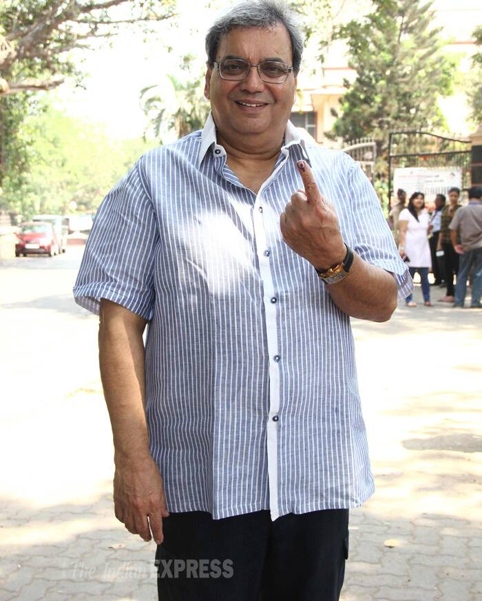 Filmmaker Subhash Ghai shows his inked finger outside the polling station in Mumbai. (Photo: Varinder Chawla)