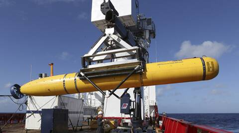 The Phoenix International Autonomous Underwater Vehicle (AUV) Artemis is craned over the side of Australian Defense Vessel Ocean Shield before launching the vehicle into the southern Indian Ocean in the search of the missing Malaysia Airlines Flight 370. (AP)