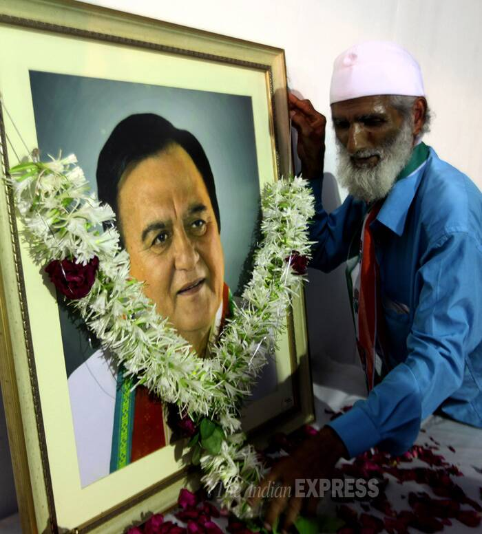 Congress party worker arranges the frame of late actor and MP Sunil Dutt at the election central office. (IE Photo: Prashant Nadkar)