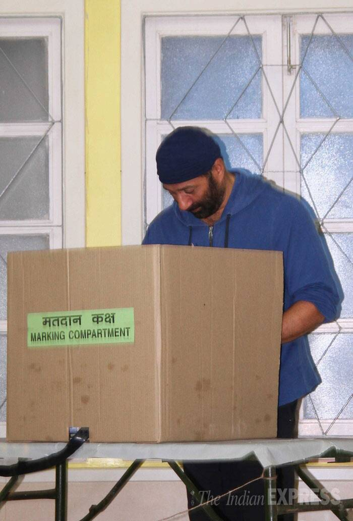 His elder son Sunny Deol seen casting his vote. (IE Photo: Amit Chakravarty)