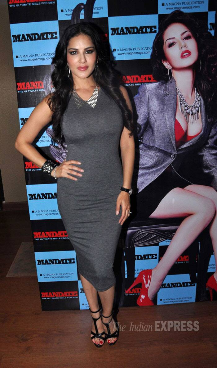 Adult-film-actress-turned-B-Town starlet, Sunny Leone launched a magazine featuring herself on the cover on Thursday (April 11). The 'Ragini MMS 2' rocked a chic grey number with black strappy heels paired with a collared necklace and earrings. (Photo: Varinder Chawla)