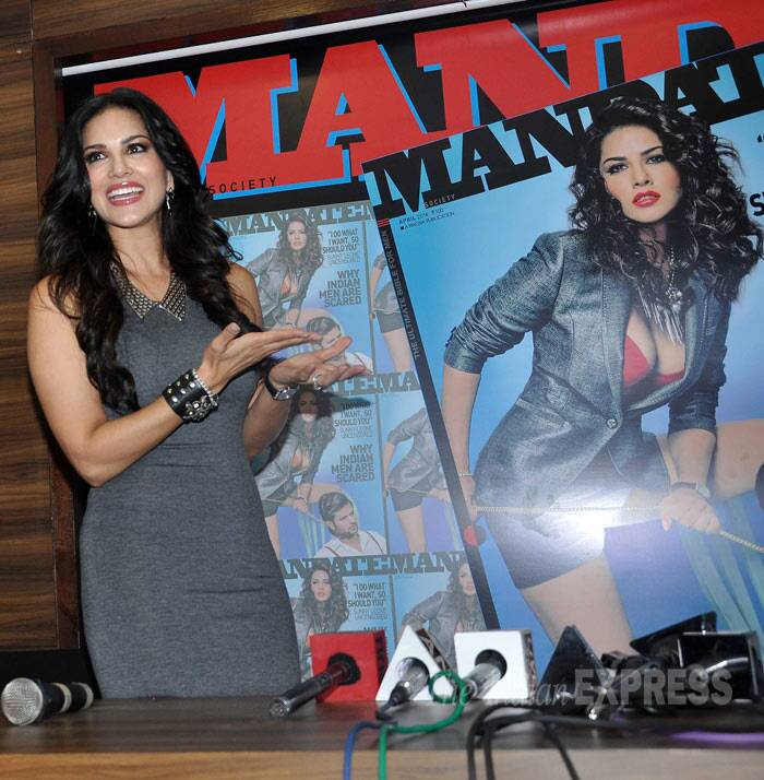 On the cover, Sunny shows plenty of cleavage in a red top with a blue jacket and shorts. (Photo: Varinder Chawla)