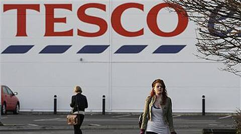 Supermarket Tesco reports profit setback in UK, says will focus on India and China