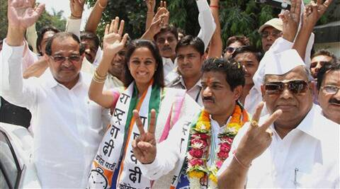 NCP candidate Sanjeev Naik alongwith NCP leaders Supriya Sule and other party workers during a roadshow in Thane, Mumbai on Friday. (PTI)