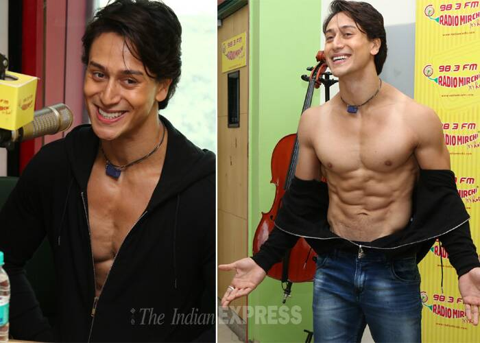 Tiger Shroff seems to be in Salman Khan mode - days after his shirtless Salman act during the promotions of 'Heropanti', Jackie Shroff's son took off his shirt for the second time. <br /><br /> Tiger, who was at a radio station in Mumbai along with Kriti Sanon, went shirtless for his fans to show off his six packs. (Photo: Varinder Chawla)