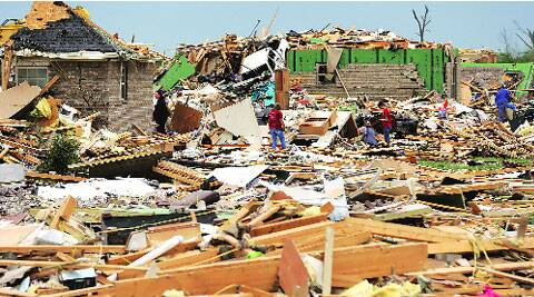 Volunteers try to salvage items for residents who lost their homes to Sunday's tornado in Arkansas Tuesday. AP