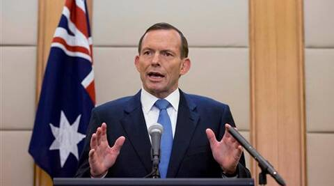 Australian Prime Minister Tony Abbott speaks during a press conference in Beijing, China Saturday. (AP)