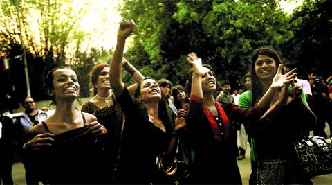 Transgenders celebrate the Supreme Court verdict in the capital on Saturday. PRAVEEN KHANNA