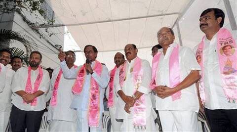 Bajireddy Govardhan of YRS Congress party and G. Krishna join TRS in presence of TRS President K. Chandra Sekhar Rao in Hyderabad on Friday. (PTI Photo)