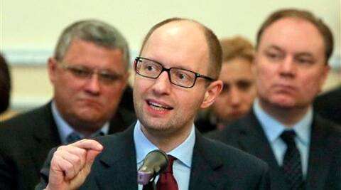 Arseniy Yatsenyuk speaks during his meeting with regional leaders in Donetsk, Ukraine, Friday. Ukraine's prime minister told leaders in the country's restive east that he is committed to allowing regions to have more powers.  (AP)