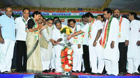 Congress leaders light the ceremonial lamp at the rally in Mandya on Monday. (Express)