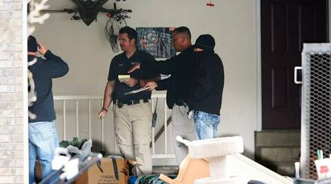 Police investigate the scene where seven infant bodies were discovered and packaged in separate containers at a home in Pleasant Grove, Utah. (AP)