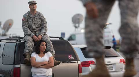 Lucy Hamlin and her husband, Spc Timothy Hamlin, wait for permission to re-enter the Fort Hood military base, where they live, following a shooting on base in Fort Hood, Texas (AP Photo).
