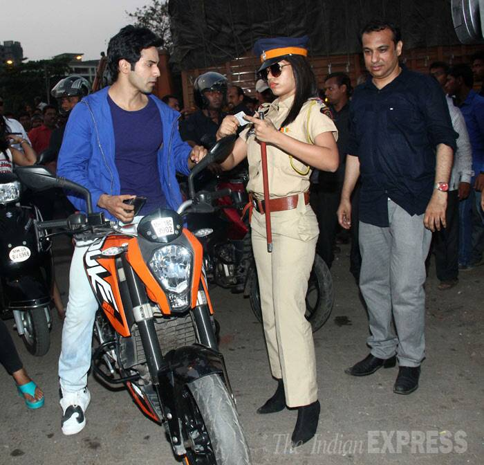 Varun Dhawan looks serious as he shows the cop his license. (Photo: Varinder Chawla)