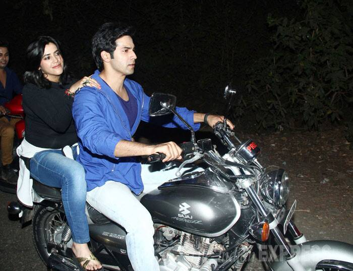 Bollywood actor Varun Dhawan took his producer Ekta Kapoor for a bike ride in Mumbai on Monday (March 31) as part of a new promotional strategy for his soon-to-release comedy 'Main Tera Hero'.  (Photo: Varinder Chawla)