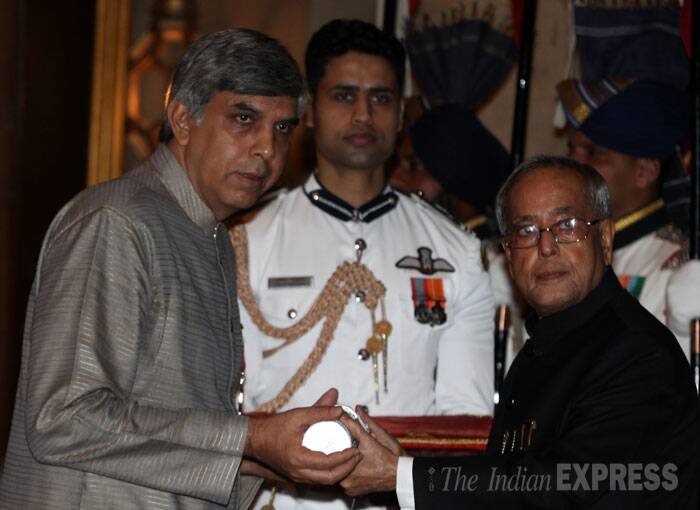 Vice Chancellor of Delhi University Dinesh Singh is seen receiving his Padma Shri Award from President Pranab Mukherjee on Saturday in New Delhi. (IE Photo: Renuka Puri)