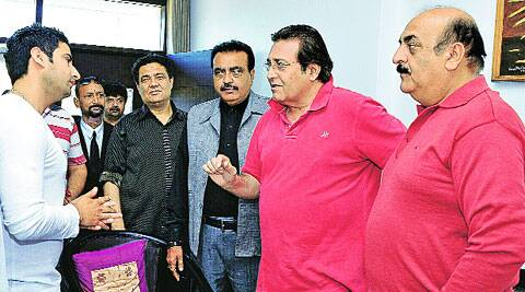Dinesh Sharma (in suit) and Samrendra Sharma (in red T-shirt) with Vinod Khanna. Express Photo