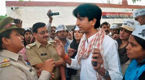 AAP leader Kumar Vishwas during his protest outside a local police station in Amethi on Friday. Also seen in the picture is party leader Shazia Ilmi. (PTI)