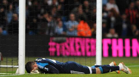 Sunderland's goalkeeper Vito Mannone reacts after a mistake that allowed Manchester City's Samir Nasri to score the equalizer during their English Premier League match on Wednesday. (AP)