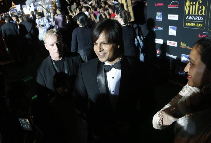 "At the event Vivek Oberoi was asked to star in another adult comedy by his cheeky fans. A witty Vivek replied, ""There is so much energy here. Fans are shouting 'Grand Masti'. There is a demand for a third film again. I think it should come. But I will have to ask my wife if I can do it."" (AP)"