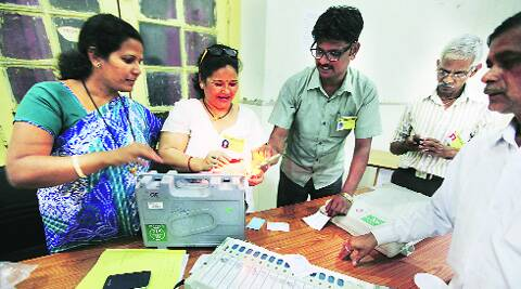 Polling officers seal the EVMs at a centre in Kumtekar Road.