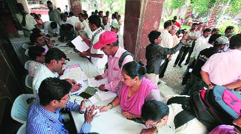People submit written applications on Friday. (Photo: Arul Horizon)